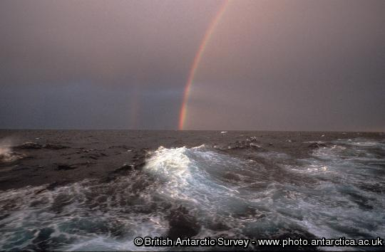 Rainbow seen on a stormy day at sea