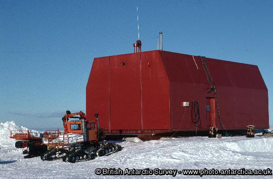 Garage on skis - external. The garage is built on skis and is moved to a new location each year to prevent it becoming buried in snow.
