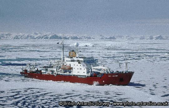 RRS James Clark Ross in pack ice, in Marguerite Bay, close to Rothera research station. The mountains of the Antarctic Peninsula are in the background.