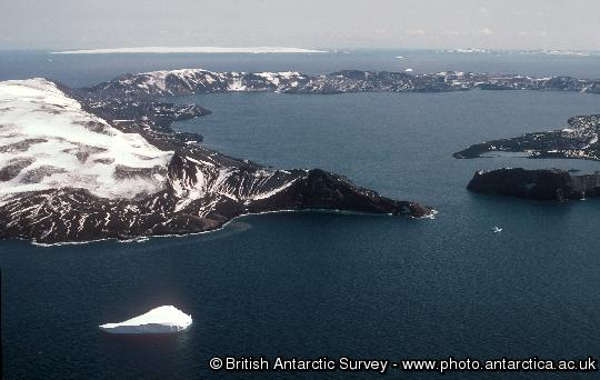 Deception Island, South Shetland Islands, showing the 10km diameter flooded caldera.  The caldera collapsed approximately 10,000 years ago following a major eruption. Several smaller eruptions occurred between 1967 and 1970. The island is visited by around 10,000 tourists each year.