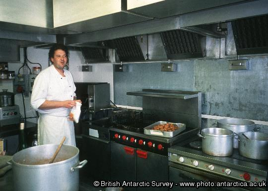 Cyril Millet, the wintering Rothera Chef preparing lunch in the kitchen.