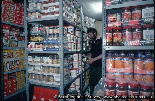 The Rothera cook in the food store
