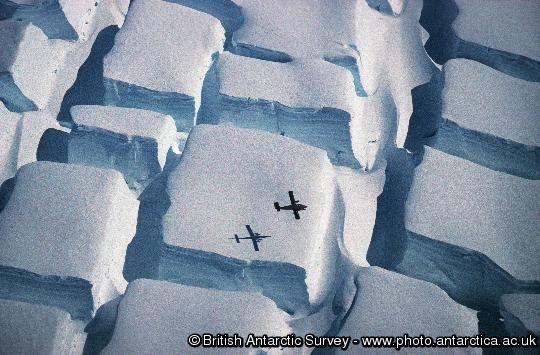 BAS Twin Otter flying low over a striking crevasse field on the English Coast, Palmer Land on the Antarctic Peninsula.  
