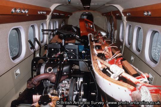 Interior of a BAS Twin Otter, fully loaded with cargo.