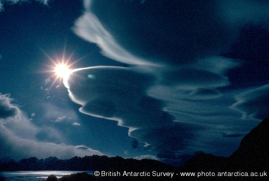 A stack of plate clouds above South Georgia - altocumulus lenticularis - stationary wave clouds caused by airflow over mountains