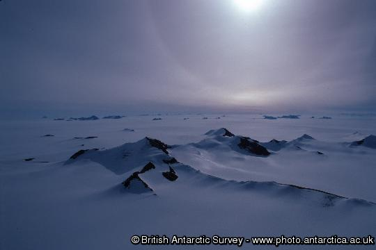 A nunatak stands out from the Antarctic Ice Sheet south of the Antarctic Peninsula