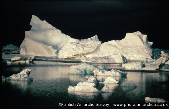 Iceberg in North Bay. Black background caused by approaching storm.
