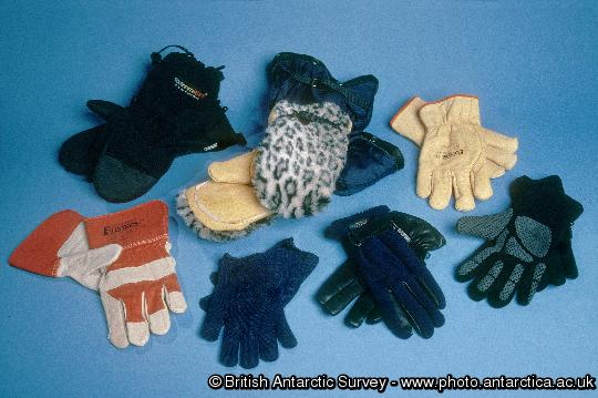 Antarctic Clothing Pictures Gloves / Mitts.Upper: Std mitts, Bearpaw Mitts, insulated work ves. Lower: work Gloves, Liner Gloves , Leather/fleece Field Glove, Windproof liner Glove.