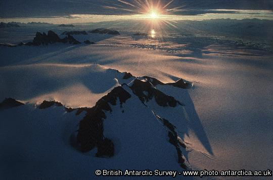 Evening light: Looking from above the Antarctic Peninsula over George VI Sound towards Alexander Island.