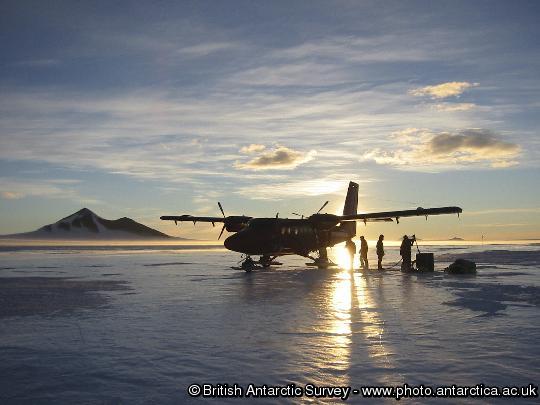 BAS Twin otter Aircraft refuels at Sky Blu runway under the midnight sun