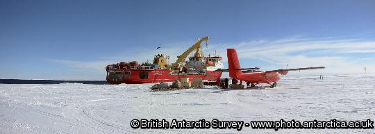 A BAS twin otter aircraft on the sea ice at Dresher Inlet. The aircraft is seen alongside RRS Shackleton during the airborne relief of Halley Research Station.