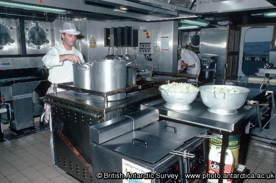 A cook in the  galley onboard of RRS James Clark Ross