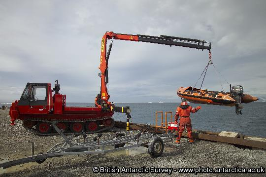 Inflatable boat being lowered into the water at Rothera's wharf. Boat transport allows both marine and terrestrial biologists to investigate sites further from the Station.