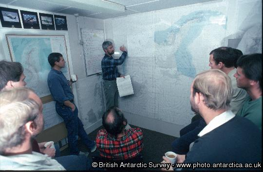 Morning briefing in the Operations Room at Rothera. Weather reports being given to pilots.