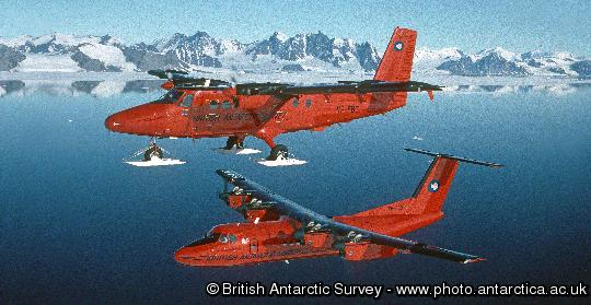 British Antarctic Survey ski-equiped Twin Otter and Dash-7 aircraft  above Rothera research station, Adelaide Island, Antarctica.