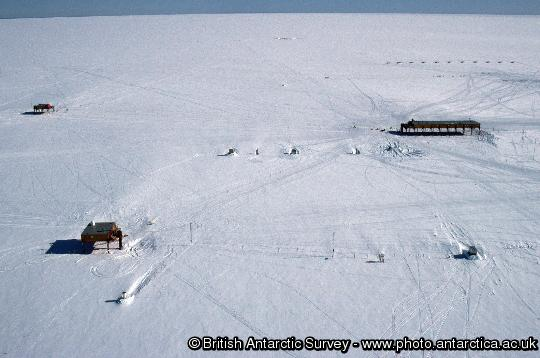 Aerial view of the Halley Research station showing the three platforms. The Simpson building is in the foreground.