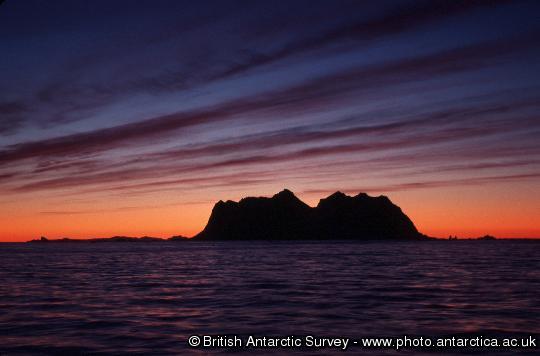 Sunset illuminating bands of cirrus clouds