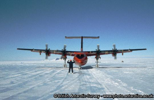 Dash 7 being directed to cargo stance at Sky-Blu. The wheeled Dash 7 aircraft routinely operates between Rothera and a blue ice runway at Sky-Blu where a fuel depot is maintained for use by the fleet of Twin Otter aircraft.