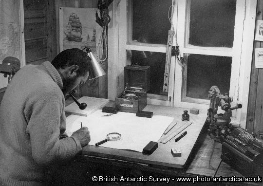 Wally Herbert at work on map in survey office at Hope Bay Station, Trinity Peninsula, Antarctica