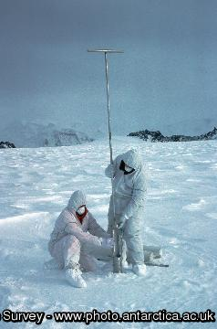 Scientists use a hand drill to take 10 metre ice cores