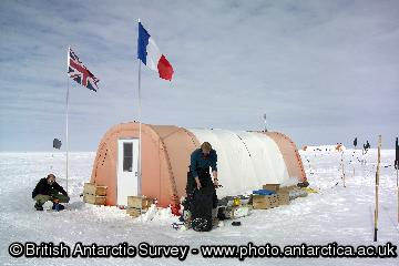 Living accommodation at a Berkner Island drilling site. Scientists have succeeded in drilling 1000 metre-deep ice core and reached bedrock. The core gives a continuous record of the climate on Berkner spanning the past 30,000 years. This period is particularly interesting as it includes the dramatic tranition from the last ice age into the current Holocene warm period, when the average temperature of the Antarctic rose by 8C. Situated at the southern end of the Atlantic Ocean, the Berkner Island coast will give a clear view of the southern response to changes in ocean currents that are believed to have occurred during this period. This image is associated with the 2005-2010 BAS science programme: CACHE- Climate and Chemistry: Forcings, Feedbacks and Phasings in the Earth System.