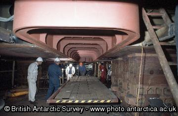 One of the transducer units being fitted in the hull of the ship