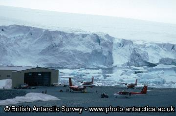 The air facility at Rothera Research Station with the hangar in the background and 4 aircraft (Dash 7 and Twin Otter) in the foreground