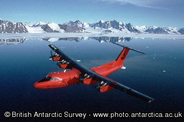 BAS Dash 7 over the mountains of the Antarctic Peninsula close to Rothera Research Station.