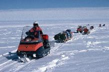 A remote field party travelling between sites using Bombardier skidoos and Nansen Sledges.  The party of four required more than 6 tonnes of equipment but were autonomous for 10 weeks. Snow-mobiles are extensively used at the BAS stations and at remote field locations. These small vehicles are used for personal transport and for towing Nansen sledges. BAS operates Bombardier Ski-doos which are simple to ride with just a twist grip throttle and a brake. They have a fully automatic transmission and a track underneath with skis at the front to steer. Ski-doos can attain speeds of up to 50 mph on smooth snow.