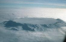 Aerial view pf the 5-6 Km Diameter Ice-filled summit caldera and upper slopes of Mt Hampton, a mid-Miocene alkaline stratovolcano in the Executive Committee Range, investigated by British and American geologists as part of the WAVE (West Antarctic Volcano Exploration) project.
