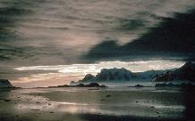Adelaide Island from Rothera and clouds relectd in a calm sea
