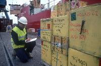 John Shears checks Hazadous waste being unloaded from RRS Shackleton at Grimsby docks