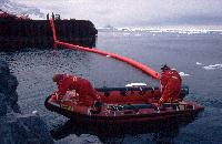 An oil spill defence boom being deployed during an exercise at Rothera Research Station