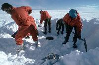Shovelling snow into the melt tank to provide the fresh water at Halley Research Station
